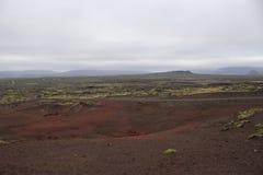 Lava field in Snaefellsnes peninsula in Iceland. Huge lava field and red sand in Snaefellsnes peninsula in West stock photos