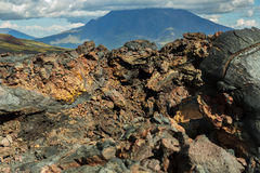 Lava field at Tolbachik volcano, after eruption in 2012 on background Big Udina volcano, Kamchatka Royalty Free Stock Images