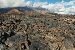 Lava field at Tolbachik volcano, after eruption in 2012 on background Plosky Tolbachik volcano, Klyuchevskaya Group of Royalty Free Stock Image