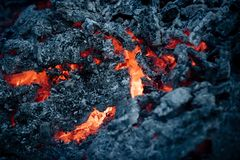 Lava flame on black ash background. Magma textured molten rock surface. Volcano, fire, crust. Danger, hazard, energy concept. Formation geology nature stock photos