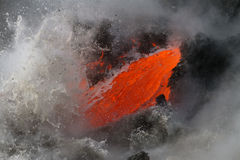 Lava flow. Enters the sea in Hawaii royalty free stock images