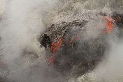 Lava flow. Enters the sea in Hawaii royalty free stock photography