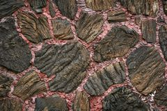 Lava flow wall. Lava rock pattern, laid in wall of a building, rough texture Royalty Free Stock Photos