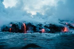 Lava flow into water Royalty Free Stock Images