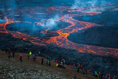Free Lava Flowing During Volcanic Eruption. Stock Photo - 214546800
