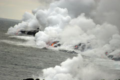 Lava flowing into the ocean Royalty Free Stock Image