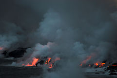 Lava flowing into the ocean Royalty Free Stock Images