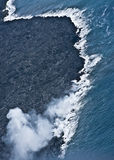 Lava Flowing Into Ocean stock photo