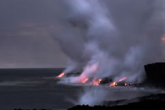 Lava flowing into the ocean Stock Image