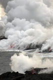 Lava flowing into the ocean stock photos