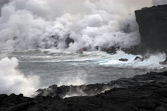 Lava flowing into the ocean Stock Images