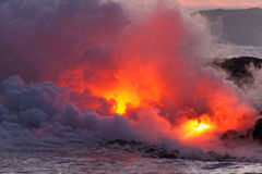 Lava flowing into ocean - Kilauea Volcano, Hawaii. Lava flowing into ocean - Kilauea Volcano, Big Island, Hawaii Stock Photos