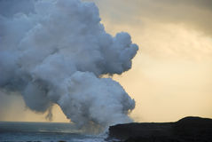 Lava flowing into sea Stock Photography