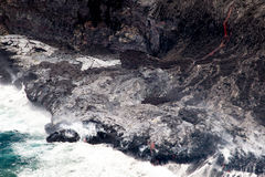 Lava flowing into the sea Royalty Free Stock Photography
