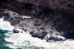 Lava flowing into the sea Royalty Free Stock Photos