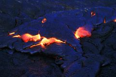 Lava Flows From Hawaii's Kīlauea Volcano. Active lava flow breaks through the crust at the Kalapana lava fields, on the Big Island of Hawaii Royalty Free Stock Image