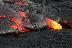Lava Flows From Hawaii's Kīlauea Volcano. Active lava flow breaks through the crust at the Kalapana lava fields, on the Big Island of Hawaii Royalty Free Stock Photography