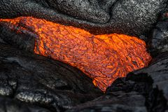 Lava on Hawaii`s Big Island. Lava flows to create new island on the Big Island of Hawaii Stock Photo