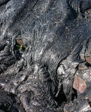 Lava Frozen in Time. Lava cooled into filaments which while black in color reflect the sun Royalty Free Stock Images