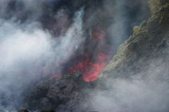 Lava and fumes. View of rock heaten to incandescence by lava on the top of Pacaya volcano in Guatemala Royalty Free Stock Images