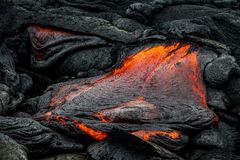 Lava on Hawaii`s Big Island. Lava flows to create new island on the Big Island of Hawaii Royalty Free Stock Photography