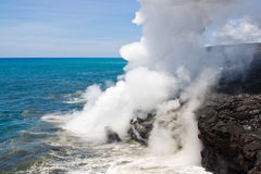 Lava haze in Hawaii. Lava haze (laze) is an acidic cloud that contains lots of hydrochloric acid. It is a result of a chemical reaction between seawater and hot Royalty Free Stock Photography