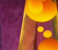 Lava Lamp. With yellow contents Stock Photos