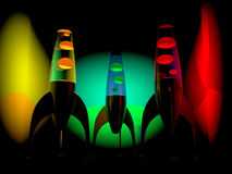 Lava Lamps dark. Three colored lava lamps lighting up the environment Royalty Free Stock Images