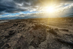 Lava landscape of Iceland. Sunset over the vast volcanic Moon like desert with rocks of lava hiden in the highlands of Iceland which makes it accesible only with Stock Photography