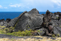 Lava a lo largo del camino en la isla grande, Hawaii Imagenes de archivo