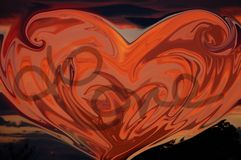 Lava love. An orange colored heart with love written in the center Stock Photography