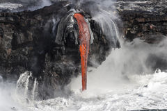 Lava meets the ocean in Hawaii Stock Photo
