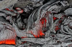 Lava is molten rock generated by geothermal energy and expelled through fractures in planetary crust or in an eruption. Usually at temperatures from 700 to 1 stock photos