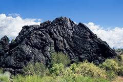 Lava Mountain near  the walkway through lava fields at Valley of Royalty Free Stock Photography