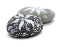 Lava pebble painting Stock Photos