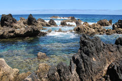 Lava pools in the ocean Royalty Free Stock Photo