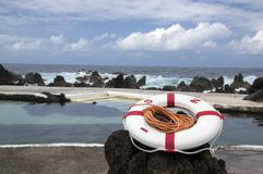 Lava pools swimming pool complex, Porto Moniz, Madeira, Portugal, red and white rescue ring stock photos