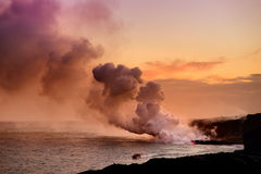 Lava pouring into the ocean creating a huge poisonous plume of smoke at Hawaii`s Kilauea Volcano, Big Island of Hawaii. Lava pouring into the ocean creating a stock image