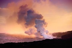 Lava pouring into the ocean creating a huge poisonous plume of smoke at Hawaii`s Kilauea Volcano, Volcanoes National Park, Hawaii. Lava pouring into the ocean stock photo