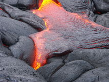 Lava print. Detail of flowing lava magma stream Stock Images
