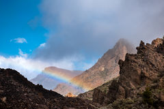 Lava and rainbow Teide volcano Tenerife Canary. Lava flows and rainbow of Teide volcano National park, Tenerife, Canary islands, Spain Stock Photo