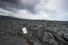 Lava on the road and a sign Royalty Free Stock Photo