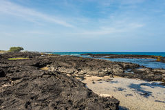 Lava rock beach in Hawaii. Beach in Hawaii, Big Island. Lava rock, ocean and blue water Royalty Free Stock Photos