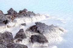 Lava Rock in Blue Lagoon Stock Image