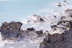 Lava Rock in Blue Lagoon Stock Images