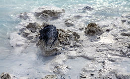 Lava Rock in Blue Lagoon Stock Photo