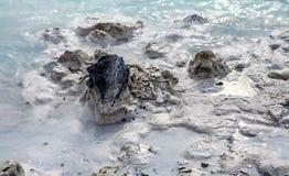 Lava Rock in Blue Lagoon Stock Photo