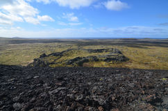 Lava Rock Covered in Moss Around a Volcanic Crater Royalty Free Stock Photo