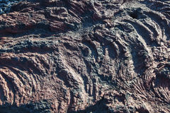 Lava rock formation texture Stock Photos