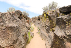 Lava rock formations. And trail Royalty Free Stock Image